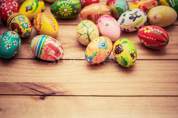 Colorful hand painted Easter eggs on wood. Unique handmade, vintage design. Stock photo © photocreo