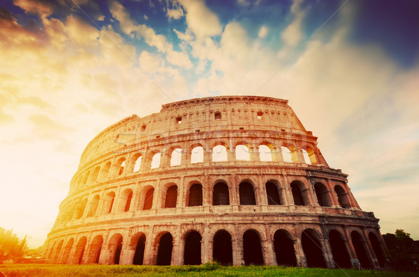 Colosseum in Rome, Italy. Amphitheatre in sunrise light. Vintage Stock photo © photocreo
