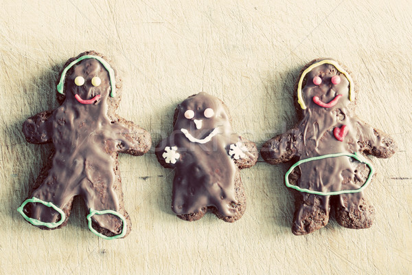 Gingerbread family. Handmade in home, decorated by children. Vintage Stock photo © photocreo