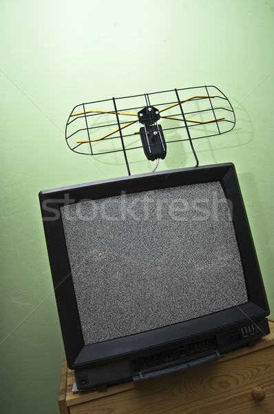 Old TV set, noisy picture, aerial. Stock photo © photocreo