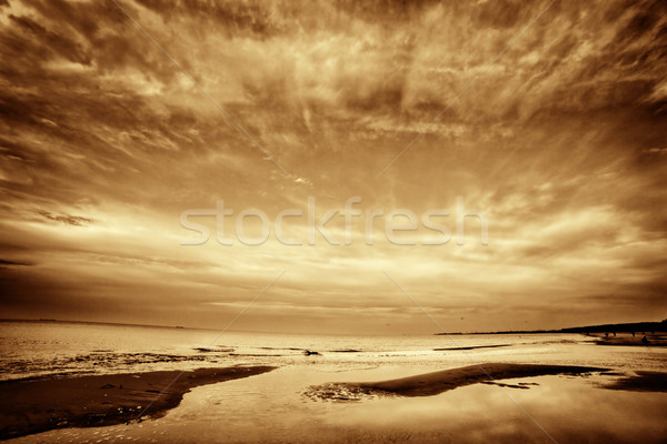 Fine art picture of sea, ocean at sunset. Dramatic sky. Stock photo © photocreo