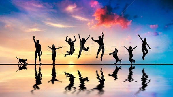 Happy friends, family with dog and cat jumping at sunset Stock photo © photocreo