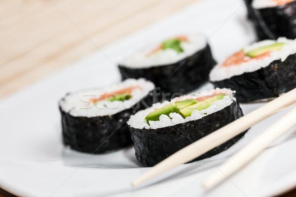 Szusi lazac avokádó rizs hínár evőpálcikák Stock fotó © photocreo