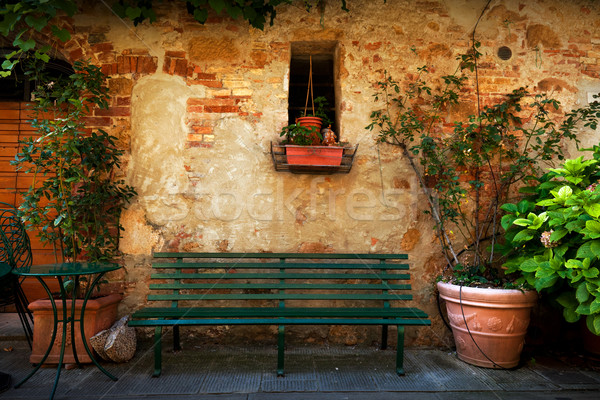 Retro bench outside old Italian house in a small town of Pienza, Italy. Vintage Stock photo © photocreo