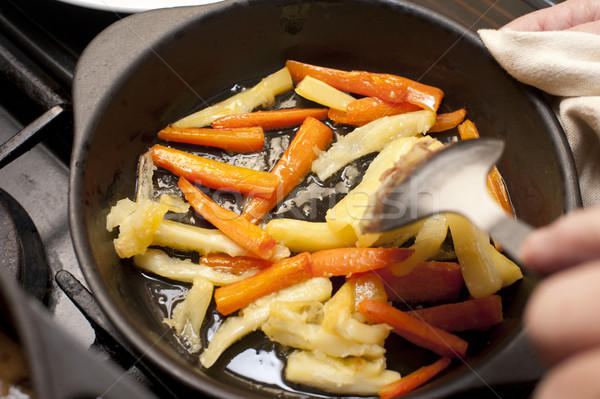 Carrot and parsnip batons being sauteed Stock photo © photohome