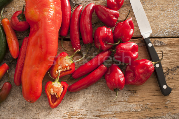 Kicsi válogatás piros forró paprikák kés Stock fotó © photohome
