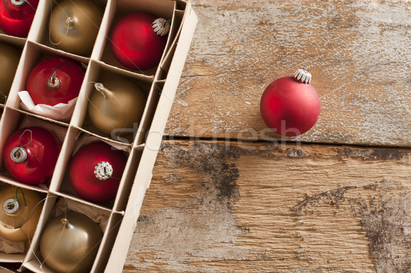 Boxed assortment or red and gold Xmas baubles Stock photo © photohome
