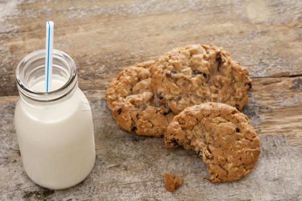 Bottle of milk with half eaten cookies Stock photo © photohome