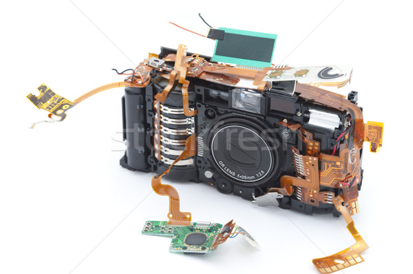 Disassembled camera with exposed copper ribbons Stock photo © photohome