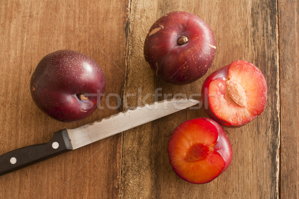 Organic Plums and Sharp Knife on Wooden Table Stock photo © photohome