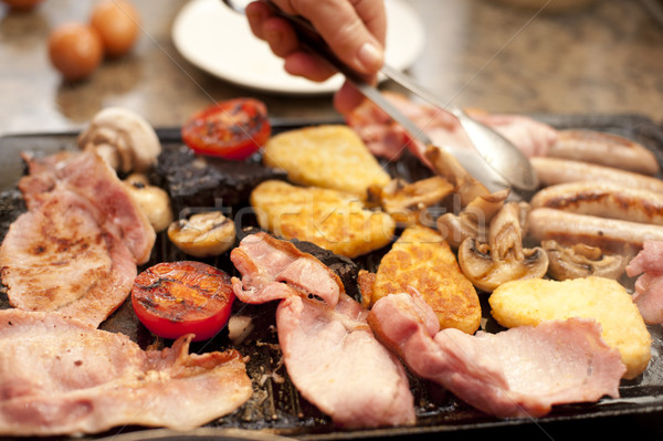 Man serving a hearty cooked breakfast Stock photo © photohome