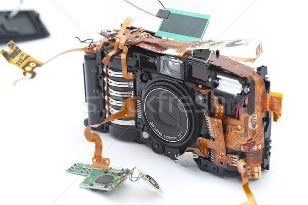 Point and shoot camera with disassembled parts Stock photo © photohome