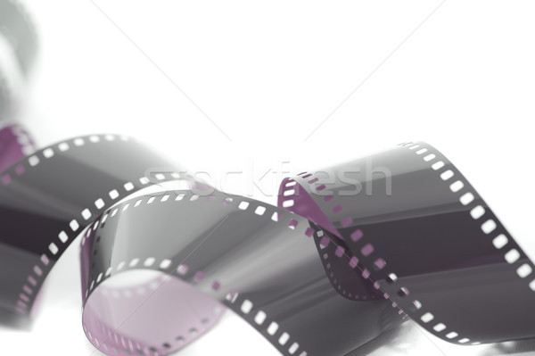 Coiled unrolled exposed 35mm film strip Stock photo © photohome