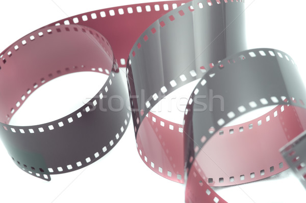 Curled up strip of film over white Stock photo © photohome