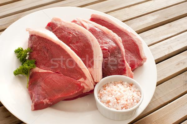 Négy nedvdús marhahús kész főzés tányér Stock fotó © photohome
