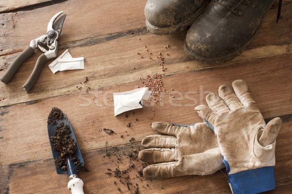Jardinería héroe piso de madera fangoso negro botas Foto stock © photohome