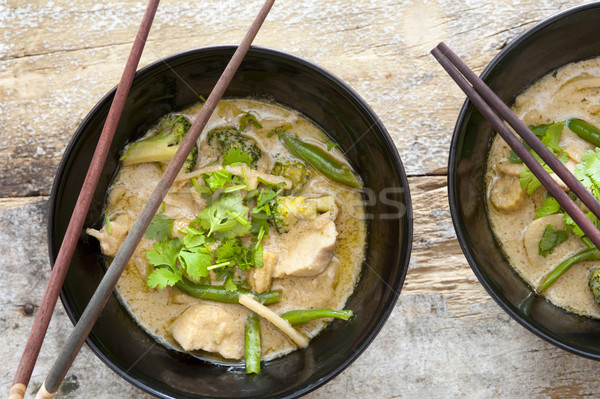 Bowls of Thai green curry with chopsticks Stock photo © photohome