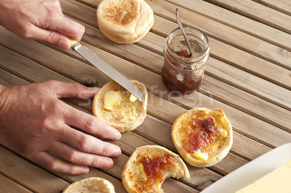 Hands spreading butter on english muffins Stock photo © photohome