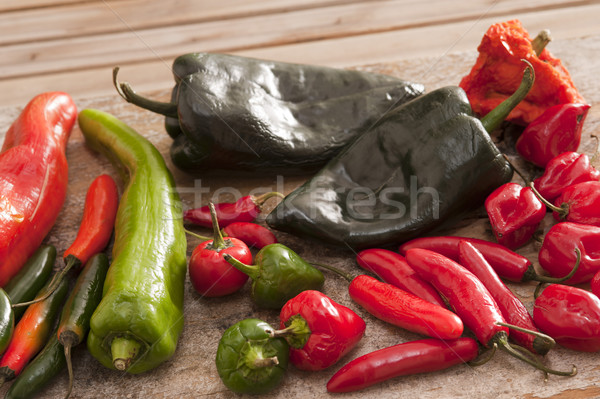 Különböző forró paprikák vágódeszka hosszú rövid Stock fotó © photohome