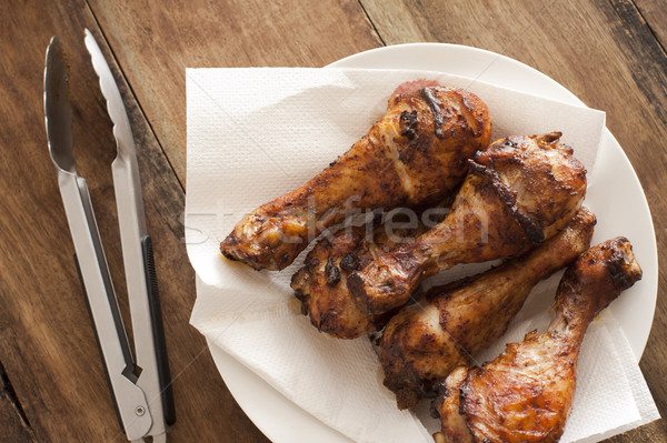 Delicious marinated grilled chicken legs Stock photo © photohome