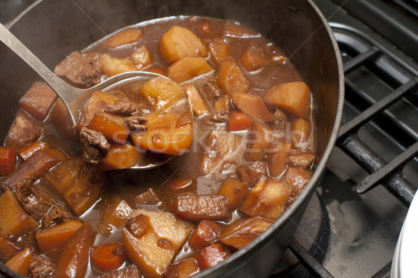 Delicious beef stew cooking in a pot Stock photo © photohome