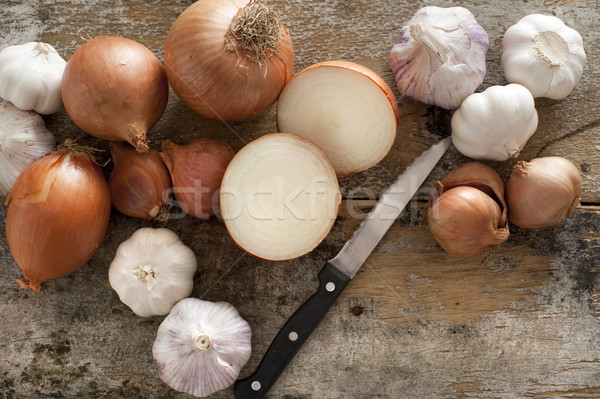 Whole and halved fresh uncooked garlic and onion Stock photo © photohome