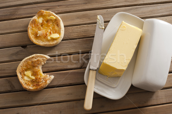 Stick of butter besides two english muffins Stock photo © photohome