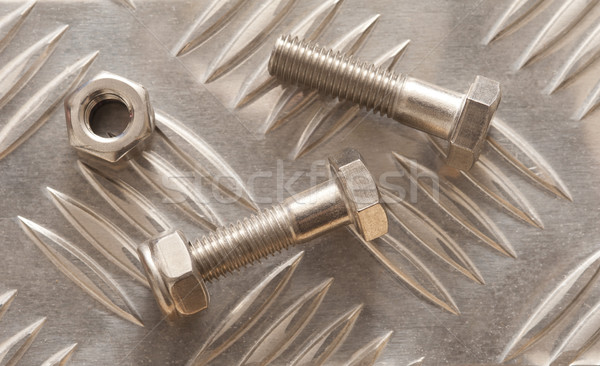 Embossed metal sheet with nuts and bolt Stock photo © photohome