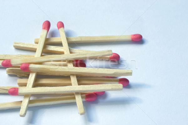 Wooden match sticks stacked one upon the other Stock photo © photohome