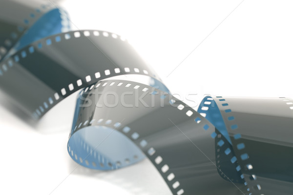 Coils of 35mm film on white Stock photo © photohome