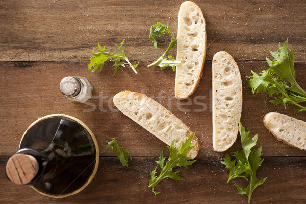 Slices of fresh baguette with rocket leaves Stock photo © photohome