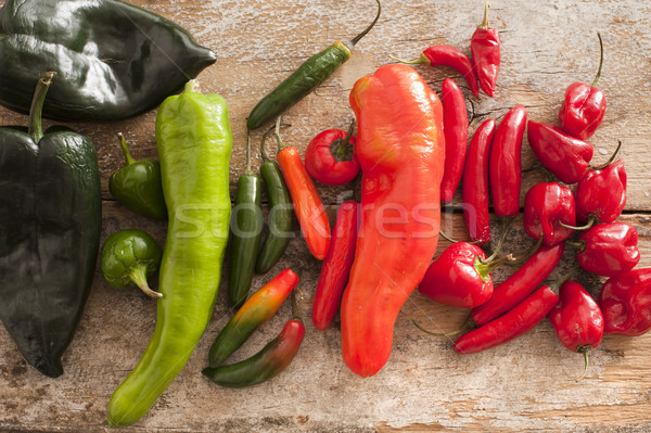 Colorful selection of spicy peppers on table Stock photo © photohome