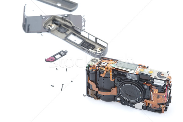 Kamera fektet fehér különböző darabok mögött Stock fotó © photohome