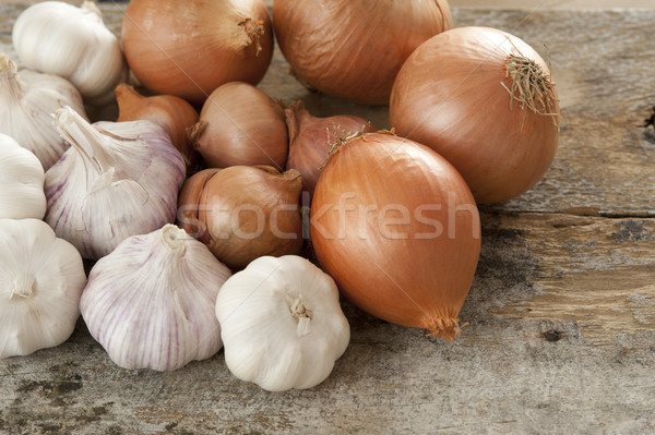 Harvest of Fresh Onions and Garlic on Wood Table Stock photo © photohome