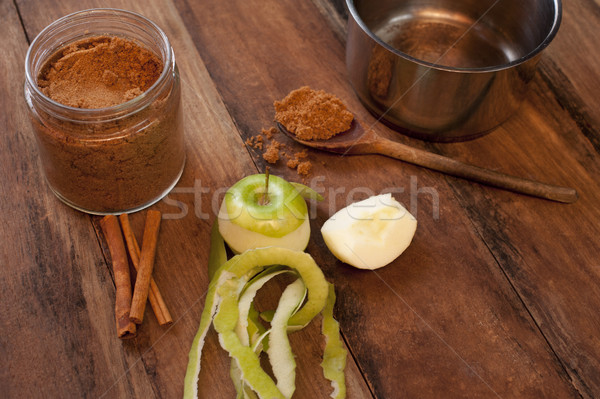 Fresh apple, cinnamon sticks and powdered spice Stock photo © photohome