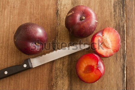 Whole and cut plums with knife on table Stock photo © photohome