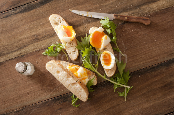 Soft cooked eggs sliced and served on bread Stock photo © photohome