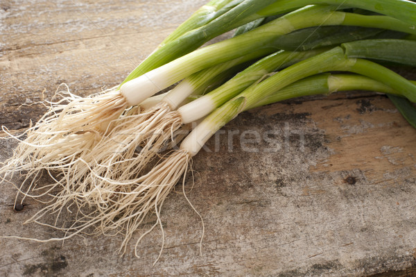 Small bunch of green onions on rustic table Stock photo © photohome