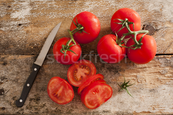 Preparing sliced ripe red tomatoes Stock photo © photohome