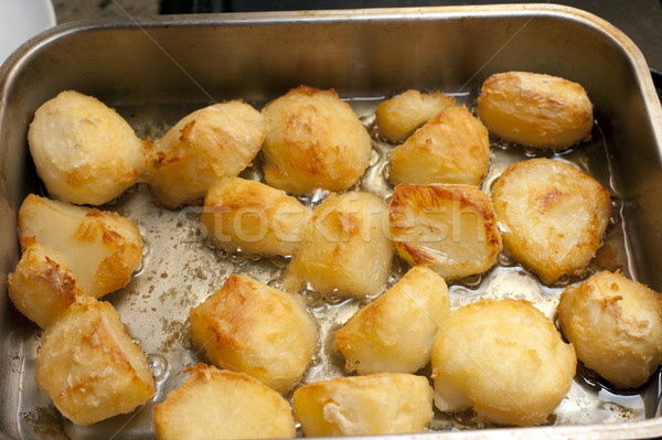 Delicious golden crispy roast potatoes Stock photo © photohome