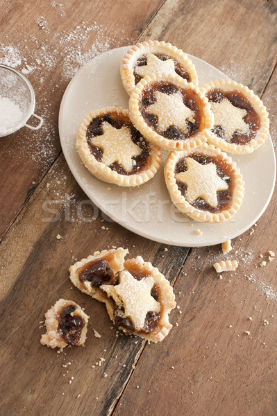 Eating tasty home baked Christmas mince pies Stock photo © photohome