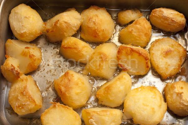 Background of delicious golden roast potatoes Stock photo © photohome