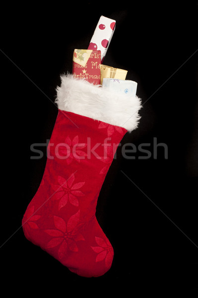 Colorful red Christmas stocking with gifts Stock photo © photohome