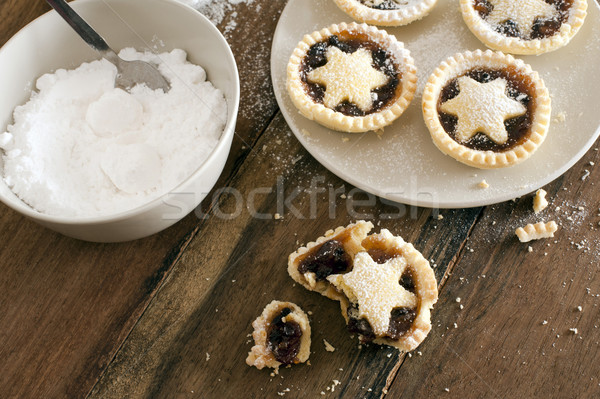 Stock photo: Eating delicious fresh baked Christmas mince pies