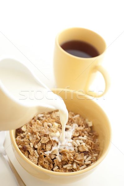 Pouring milk into breakfast cereal - high key Stock photo © photohome