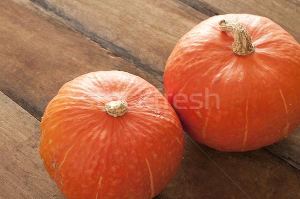Kettő egész friss ősz sütőtök fallabda Stock fotó © photohome