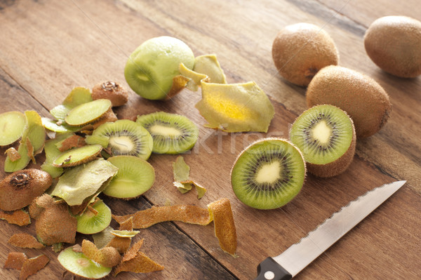 Peeling and slicing kiwifruit for dessert Stock photo © photohome