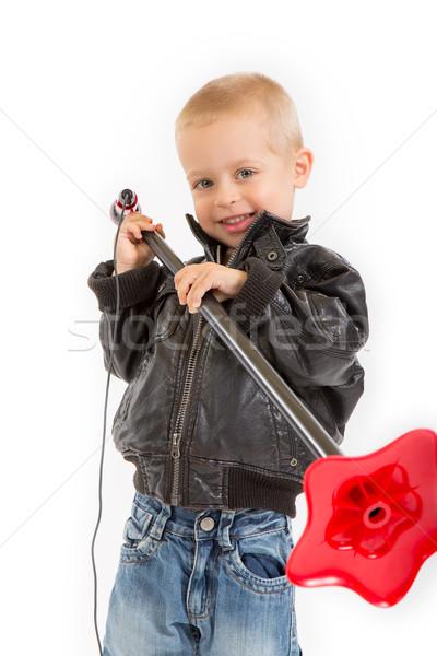 Kicsi rocker fiú mikrofon áll bőrdzseki Stock fotó © Photoline