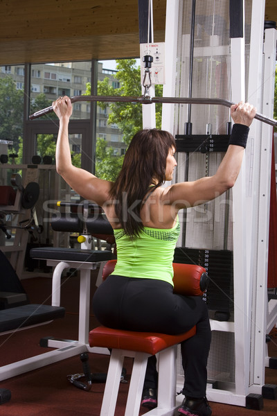 Muscular woman in the gym Stock photo © Photoline