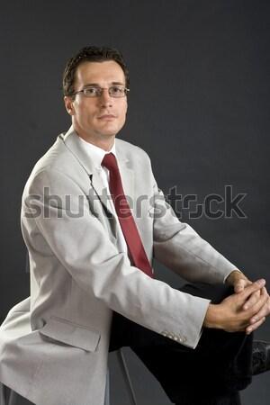 Człowiek szary kurtka czerwony tie okulary Zdjęcia stock © Photoline